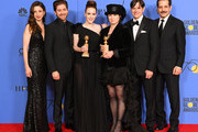 Marin Hinkle, Michael Zegen, Rachel Brosnahan, Amy Sherman-Palladino, Daniel Palladino and Tony Shalhoub pose with the award for Best Television Series Musical or Comedy for 'The Marvelous Mrs. Maisel' in the press room during The 75th Annual Golden Globe Awards at The Beverly Hilton Hotel on January 7, 2018 in Beverly Hills, California.
