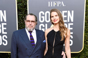 Julian Schnabel (L) and Louise Kugelberg attend the 76th Annual Golden Globe Awards at The Beverly Hilton Hotel on January 6, 2019 in Beverly Hills, California.