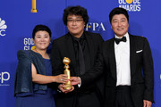 """(L-R) Lee Jung Eun, Bong Joon-ho, and Song Kang-ho pose in the press room with award for Best Motion Picture - Foreign Language for """"Parasite"""" during the 77th Annual Golden Globe Awards at The Beverly Hilton Hotel on January 05, 2020 in Beverly Hills, California."""