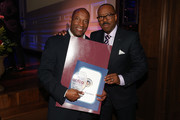 Honoree and director John Singleton (L) and actor and show presenter Courtney B. Vance attend the 7th Annual AAFCA Awards on February 10, 2016 in Los Angeles, California.