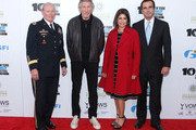 """(L-R) Martin E. Dempsey, Roger Waters, Caroline Hirsch, and Bob Woodruff attend the 7th annual """"Stand Up For Heroes"""" event at Madison Square Garden on November 6, 2013 in New York City."""