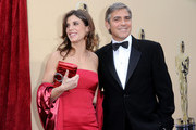 Model Elisabetta Canalis and actor George Clooney arrives at the 82nd Annual Academy Awards held at Kodak Theatre on March 7, 2010 in Hollywood, California.