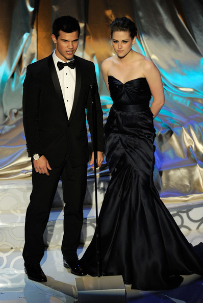 Actors Taylor Lautner and Kristen Stewart present onstage during the 82nd Annual Academy Awards held at Kodak Theatre on March 7, 2010 in Hollywood, California.