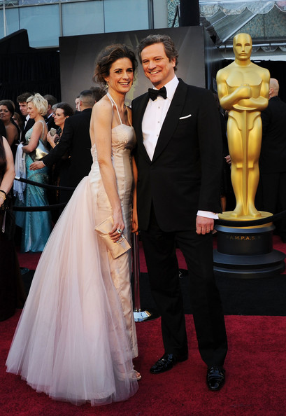 Actor Colin Firth (L) and wife Livia Giuggioli arrives at the 83rd Annual Academy Awards held at the Kodak Theatre on February 27, 2011 in Hollywood, California.
