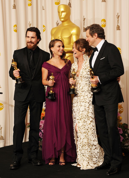 (L-R), Christian Bale, winner of the award for Best Actor in a Supporting Role for 'The Fighter', Natalie Portman, winner of the award for Best Actress in a Leading Role for 'Black Swan', Melissa Leo, winner of the award for Best Actor in a Supporting Role for 'The Fighter', and Colin Firth, winner of the award for Best Actor in a Leading Role for 'The King's Speech', pose in the press room during the 83rd Annual Academy Awards held at the Kodak Theatre on February 27, 2011 in Hollywood, California.