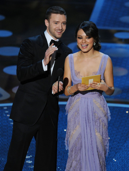 Presenters Justin Timberlake and Mila Kunis speak onstage during the 83rd Annual Academy Awards held at the Kodak Theatre on February 27, 2011 in Hollywood, California.