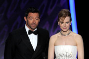 Actor Hugh Jackman (L) and actress Nicole Kidman present an award onstage during the 83rd Annual Academy Awards held at the Kodak Theatre on February 27, 2011 in Hollywood, California.