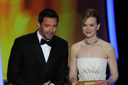 Presenters Hugh Jackman and Nicole Kidman speak onstage during the 83rd Annual Academy Awards held at the Kodak Theatre on February 27, 2011 in Hollywood, California.