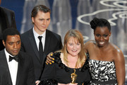 """Cast and crew of Best Picture winner """"12 Years A Slave"""" including (L-R) actors Chiwetel Ejiofor, Paul Dano, producer Bianca Stigter and actress  Adepero Oduye celebrate their win onstage during the Oscars at the Dolby Theatre on March 2, 2014 in Hollywood, California."""