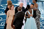 (L-R) Producer Bianca Stigter, actress Sarah Paulson, director Steve McQueen, producer Arnon Milchan, actresses Lupita Nyong'o and Adepero Oduye accept the Best Picture award for '12 Years a Slave' from actor Will Smith (2nd R) onstage during the Oscars at the Dolby Theatre on March 2, 2014 in Hollywood, California.