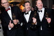 (L-R) Chris Williams, Roy Conli, and Don Hall, winners of the Best Animated Feature Award for 'Big Hero 6 attends the 87th Annual Academy Awards Governors Ball at Hollywood & Highland Center on February 22, 2015 in Hollywood, California.