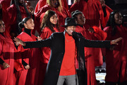 Ne-Yo performs onstage with choir at the 87th Annual Rockefeller Center Christmas Tree Lighting Ceremony at Rockefeller Center on December 04, 2019 in New York City.
