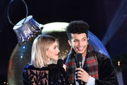 Jordan Fisher (R) and Julianne Hough perform onstage at the 87th Annual Rockefeller Center Christmas Tree Lighting Ceremony at Rockefeller Center on December 04, 2019 in New York City.