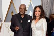 Actor Louis Gossett Jr. and Candy Brown attend the 88th Annual Academy Awards at Hollywood & Highland Center on February 28, 2016 in Hollywood, California.