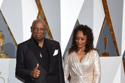 Actor Louis Gossett, Jr. (L), and Candy Brown attend the 88th Annual Academy Awards at Hollywood & Highland Center on February 28, 2016 in Hollywood, California.