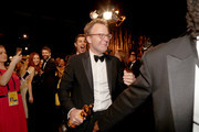 Josh Singer and Tom McCarthy, winners of the award for Best Original Screenplay for 'Spotlight,' attend the 88th Annual Academy Awards Governors Ball at Hollywood & Highland Center on February 28, 2016 in Hollywood, California.