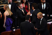 (L-R) Actors Reese Witherspoon, Matt Damon, Benicio del Toro, and musician Pharrell Williams in the audience during the 88th Annual Academy Awards at the Dolby Theatre on February 28, 2016 in Hollywood, California.