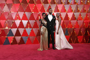(L-R) Lupita Nyong'o, and Winston Duke and Danai Gurira attend the 90th Annual Academy Awards at Hollywood & Highland Center on March 4, 2018 in Hollywood, California.