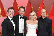 (L-R) Bryan Unkeless, Tom Ackerley, Margot Robbie, and Craig Gillespie attend the 90th Annual Academy Awards at Hollywood & Highland Center on March 4, 2018 in Hollywood, California.