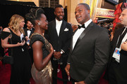 (L-R) Lupita Nyong'o, Winston Duke, and Marcus Henderson attend the 90th Annual Academy Awards at Hollywood & Highland Center on March 4, 2018 in Hollywood, California.