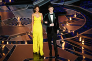 Actors Eiza Gonzalez (L) and Ansel Elgort walk onstage during the 90th Annual Academy Awards at the Dolby Theatre at Hollywood & Highland Center on March 4, 2018 in Hollywood, California.