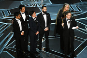 (L-R) Actors Gael Garcia Bernal, Benjamin Bratt and Anthony Gonzalez, co-directors Adrian Molina and Lee Unkrich, and producer Darla K. Anderson accept Best Animated Feature Film for 'Coco' onstage during the 90th Annual Academy Awards at the Dolby Theatre at Hollywood & Highland Center on March 4, 2018 in Hollywood, California.