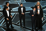 (L-R) Actors Gael Garcia Bernal and Benjamin Bratt, co-director Adrian Molina, actor Anthony Gonzalez, co-director Lee Unkrich, and producer Darla K. Anderson accept Best Animated Feature Film for 'Coco' onstage during the 90th Annual Academy Awards at the Dolby Theatre at Hollywood & Highland Center on March 4, 2018 in Hollywood, California.