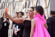 (L-R) Ashley Graham and Gemma Chan pose for a selfie photo during the 91st Annual Academy Awards at Hollywood and Highland on February 24, 2019 in Hollywood, California.
