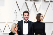 (L-R) Gloria Campano,  Bradley Cooper, and Irina Shayk attend the 91st Annual Academy Awards at Hollywood and Highland on February 24, 2019 in Hollywood, California.
