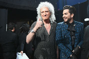 In this handout provided by A.M.P.A.S., Brian May and Adam Lambert pose backstage during the 91st Annual Academy Awards at the Dolby Theatre on February 24, 2019 in Hollywood, California.