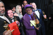 In this handout provided by A.M.P.A.S., Spike Lee (2nd from R), Charlie Wachtel, David Rabinowitz, and Kevin Willmott pose with the Best Adapted Screenplay award for 'BlacKkKlansman' backstage during the 91st Annual Academy Awards at the Dolby Theatre on February 24, 2019 in Hollywood, California.