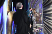 In this handout provided by A.M.P.A.S., presenters Chris Evans and Jennifer Lopez walk onstage during the 91st Annual Academy Awards at the Dolby Theatre on February 24, 2019 in Hollywood, California.