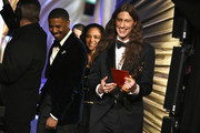 In this handout provided by A.M.P.A.S., Michael B. Jordan and Tessa Thompson walk off stage after presenting the Best Original Score award for 'Black Panther' to Ludwig Goransson (R) during the 91st Annual Academy Awards at the Dolby Theatre on February 24, 2019 in Hollywood, California.
