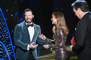 In this handout provided by A.M.P.A.S., presenters Chris Evans and Jennifer Lopez pose backstage during the 91st Annual Academy Awards at the Dolby Theatre on February 24, 2019 in Hollywood, California.