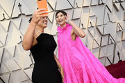 (L-R) Ashley Graham and Gemma Chan attend the 91st Annual Academy Awards at Hollywood and Highland on February 24, 2019 in Hollywood, California.