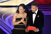 (L-R) Tessa Thompson and Michael B. Jordan speak onstage during the 91st Annual Academy Awards at Dolby Theatre on February 24, 2019 in Hollywood, California.