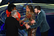 (L-R) Jay Hart and Hannah Beachler accept the Production Design award for 'Black Panther' from Jennifer Lopez and Chris Evans onstage during the 91st Annual Academy Awards at Dolby Theatre on February 24, 2019 in Hollywood, California.