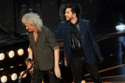 Adam Lambert (R) and Brian May of Queen perform onstage during the 91st Annual Academy Awards at Dolby Theatre on February 24, 2019 in Hollywood, California.