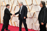 (L-R) Zack Gottsagen, Robert De Niro, and Al Pacino attend the 92nd Annual Academy Awards at Hollywood and Highland on February 09, 2020 in Hollywood, California.