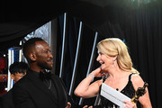 In this handout photo provided by A.M.P.A.S. Mahershala Ali and Best Actress in a Supporting Role winner Laura Dern speak backstage during the 92nd Annual Academy Awards at the Dolby Theatre on February 09, 2020 in Hollywood, California.