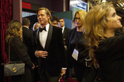 In this handout photo provided by A.M.P.A.S. Best Actor in a Supporting Role winner Brad Pitt walks backstage during the 92nd Annual Academy Awards at the Dolby Theatre on February 09, 2020 in Hollywood, California.