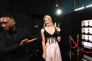 In this handout photo provided by A.M.P.A.S. Mahershala Ali and Best Actress in a Supporting Role winner Laura Dern pose backstage during the 92nd Annual Academy Awards at the Dolby Theatre on February 09, 2020 in Hollywood, California.