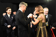In this handout photo provided by A.M.P.A.S. Timothée Chalamet, Best Adapted Screenplay winner Taika Waititi, and Natalie Portman speak backstage during the 92nd Annual Academy Awards at the Dolby Theatre on February 09, 2020 in Hollywood, California.