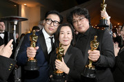 "(L-R) Screenwriter Han Jin-won, producer Kwak Sin-ae and director Bong Joon-ho, winners of the Original Screenplay, International Feature Film, Directing, and Best Picture awards for ""Parasite,"" attend the 92nd Annual Academy Awards Governors Ball at Hollywood and Highland on February 09, 2020 in Hollywood, California."