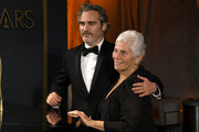 """(L-R) Joaquin Phoenix, winner of the Actor in a Leading Role award for """"Joker,"""" and Arlyn Phoenix attend the 92nd Annual Academy Awards Governors Ball at Hollywood and Highland on February 09, 2020 in Hollywood, California."""