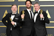 """Visual effects supervisors Guillaume Rocheron, Dominic Tuohy, and Greg Butler, winners of the Visual Effects award for """"1917,""""  pose in the press room during the 92nd Annual Academy Awards at Hollywood and Highland on February 09, 2020 in Hollywood, California."""