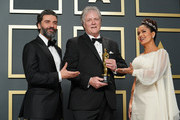 """(L-R) Oscar Isaac, Donald Sylvester, winner of the Sound Editing award for """"Ford v Ferrari,"""" and Salma Hayek pose in the press room during the 92nd Annual Academy Awards at Hollywood and Highland on February 09, 2020 in Hollywood, California."""