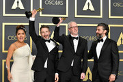 """Sound editors Mark Taylor and Stuart Wilson, winners of the Sound Mixing award for """"1917,""""  pose with Salma Hayek (L) and Oscar Isaac (R) in the press room during the 92nd Annual Academy Awards at Hollywood and Highland on February 09, 2020 in Hollywood, California."""
