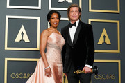 """(L-R) Regina King and Brad Pitt, winner of Best Actor in a Supporting Role for """"Once Upon a Time...in Hollywood"""" pose in the press room during 92nd Annual Academy Awards at Hollywood and Highland on February 09, 2020 in Hollywood, California."""
