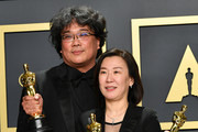 "Director Bong Joon-ho and producer Kwak Sin-ae, winners of the Original Screenplay, International Feature Film, Directing, and Best Picture awards for ""Parasite,"" pose in the press room during the 92nd Annual Academy Awards at Hollywood and Highland on February 09, 2020 in Hollywood, California."